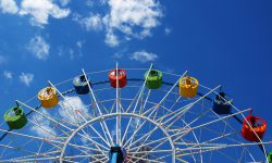 Ferris wheel in the spring amusement park awaits visitors